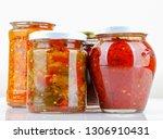preserved vegetables on white... | Shutterstock . vector #1306910431