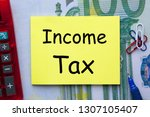 income tax written on note with ...   Shutterstock . vector #1307105407