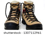 a pair of hiking boots.... | Shutterstock . vector #1307112961
