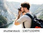 caucasian man taking photo | Shutterstock . vector #1307132494