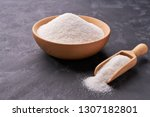 wooden bowl and scoop with... | Shutterstock . vector #1307182801