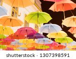 many multiple colors umbrella... | Shutterstock . vector #1307398591