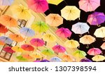 many multiple colors umbrella... | Shutterstock . vector #1307398594