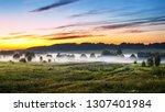 the village in the morning fog. ...   Shutterstock . vector #1307401984