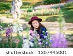 young women and flower care in... | Shutterstock . vector #1307445001