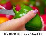 holds in hands a bell pepper....   Shutterstock . vector #1307512564