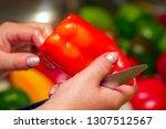 holds in hands a bell pepper....   Shutterstock . vector #1307512567