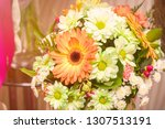 bouquet of white and orange... | Shutterstock . vector #1307513191