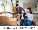happy family moving home with... | Shutterstock . vector #1307610367