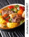 sancocho is a hearty soup ... | Shutterstock . vector #1307684827