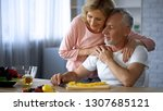happy retired couple hugging at ... | Shutterstock . vector #1307685121