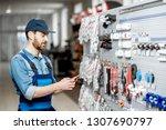 handsome electrician in... | Shutterstock . vector #1307690797
