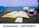 reading book with a cup of... | Shutterstock . vector #1307693617