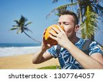 thirsty young man drinking... | Shutterstock . vector #1307764057