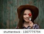 cute smiling little girl with... | Shutterstock . vector #1307775754