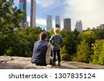 man and his charming little son ... | Shutterstock . vector #1307835124