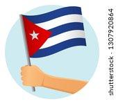 cuba flag in hand. patriotic... | Shutterstock .eps vector #1307920864