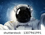 astronaut in outer space.... | Shutterstock . vector #1307961991