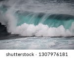 A Large Teal Color Surfing Wav...