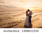 bride and groom hugging and... | Shutterstock . vector #1308011524