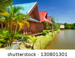 tropical holiday houses at the... | Shutterstock . vector #130801301