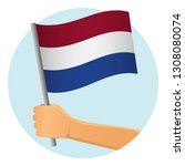 netherlands flag in hand.... | Shutterstock .eps vector #1308080074