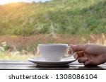 coffee espresso on wood table... | Shutterstock . vector #1308086104