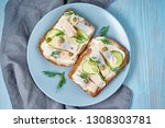 Stock photo herring smorrebrod traditional danish sandwiches black rye bread with herring on dark blue table 1308303781