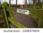 A Sign On A Gate Which Says...