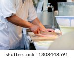 looking at cutting fish | Shutterstock . vector #1308448591
