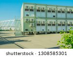 container on a construction... | Shutterstock . vector #1308585301