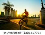 man riding sport bicycle in... | Shutterstock . vector #1308667717