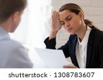 Small photo of Confused hr manager holding in hand cv listening job candidature feels bewildered and perplexed, focus on female company representative. Bad negative first impression or unsuccessful interview concept