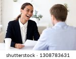 businesspeople sitting at desk... | Shutterstock . vector #1308783631