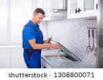 mature repairman installing... | Shutterstock . vector #1308800071