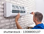mature male technician fixing... | Shutterstock . vector #1308800137