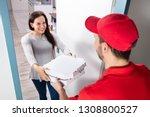 smiling woman receiving pizza... | Shutterstock . vector #1308800527