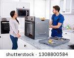 smiling repairman repairing... | Shutterstock . vector #1308800584