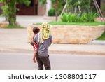rear view of khmer mother... | Shutterstock . vector #1308801517
