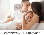happy couple with their newborn ... | Shutterstock . vector #1308849094