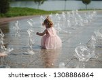 little girl plays with water in ... | Shutterstock . vector #1308886864