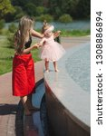 young mother with daughter at... | Shutterstock . vector #1308886894