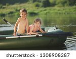 happy boy swimming in fishing... | Shutterstock . vector #1308908287