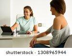 female physiotherapist... | Shutterstock . vector #1308965944