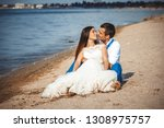 wedding couple on the beach | Shutterstock . vector #1308975757