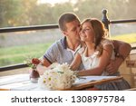 young couple in an open air cafe | Shutterstock . vector #1308975784