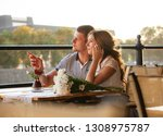 young couple in an open air cafe | Shutterstock . vector #1308975787