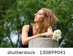 girl with daisies enjoying the sun horizontal - stock photo