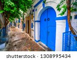 Small photo of Hammamet Medina streets with blue walls. Tunis, north Africa.