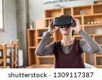 mature woman using vr headset... | Shutterstock . vector #1309117387